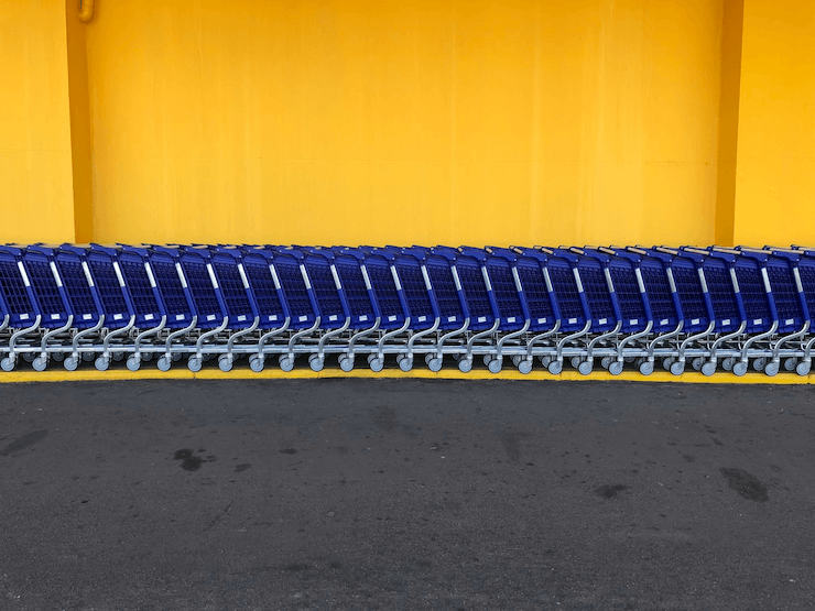 A line of carts standing near a shop
