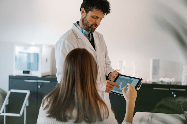 A doctor works with a patient